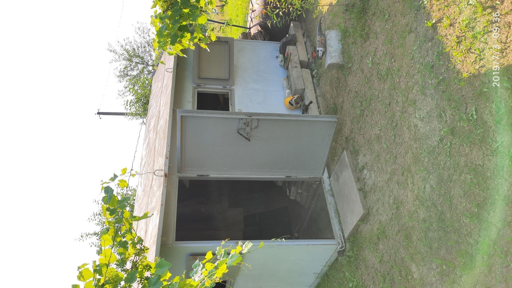 Металевий (садовий, будівельний) будиночок