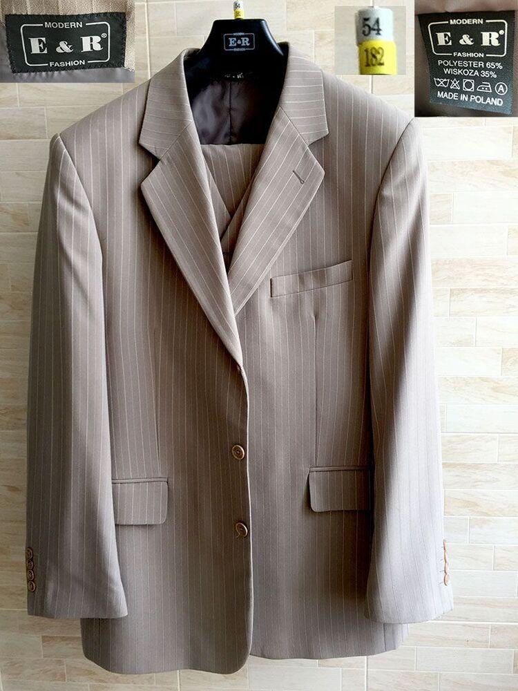 Продам новий чоловічий костюм трійка світлого кольору в смужку.